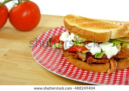 bacon lettuce and tomato sandwich on toasted bread with ripe tomatoes