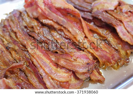bacon on metal tray - stock photo