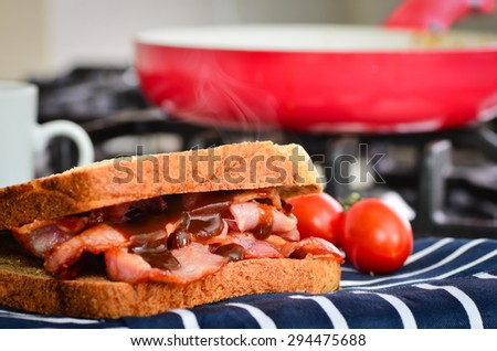 Bacon sandwich with brown sauce - stock photo