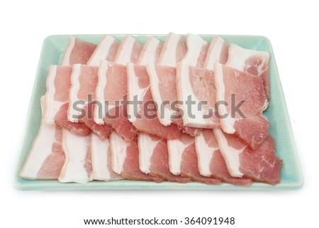 Bacon, streaky pork slice on white background - stock photo