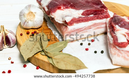 Bacon with layers of meat and spices for cooking traditional food