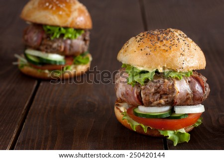 Bacon wrapped burger - stock photo