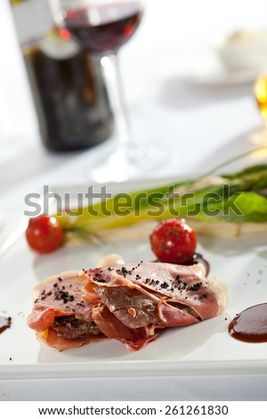 Bacon Wrapped Pork Medallions with Mashed Potato and Green Asparagus - stock photo