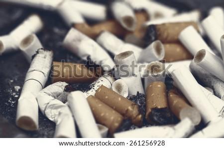 Bad addiction. Ashtray and cigarettes close-up - stock photo