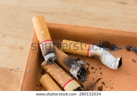 Bad addiction. Ashtray and cigarettes close-up - stock photo