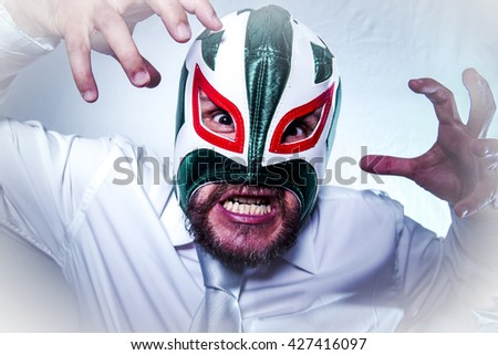 Bad, angry businessman with Mexican wrestler mask, expressions of anger and rage