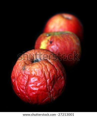 Bad apples close up on a dark background - stock photo