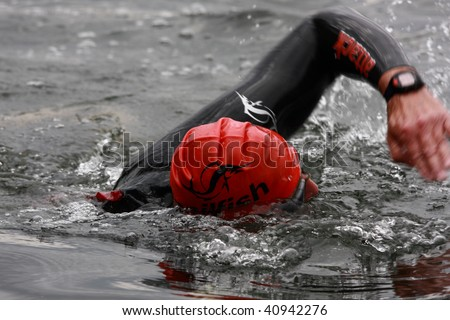 BAD AROLSEN - AUGUST 16: unknown competitor racing at Twistesee-Triathlon on August 16, 2009 in Bad Arolsen, Germany. - stock photo