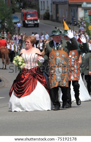 BAD AROLSEN-HELSEN, GERMANY - MAY 24: King of marksmen and his wife taking part in the pageant of Marksmen's festival, 2010 Helser Freischiessen, on May 24, 2010 in Bad Arolsen-Helsen, Germany