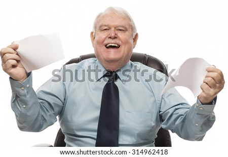 Bad Behavior Employee Series - Senior employee tearing up paperwork and smiling. - stock photo