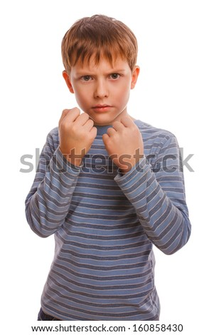 bad bully child boy blond angry aggressive fights in striped shirt isolated studio on white background - stock photo