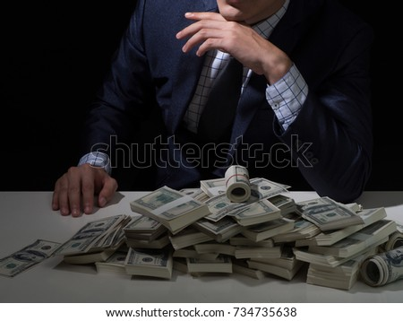 bad business man with dollar packs.Money Cash Finance Corruption Illegal Transaction Concept.