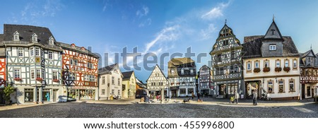 BAD CAMBERG, GERMANY - OCT 11, 2015: people enjoy historic market place in Bad Camberg. In 1000, Emperor Otto III donated the Cagenberg estate to the Burtscheid Monastery.