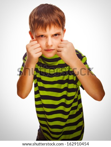 bad child boy blond bully angry aggressive fights in striped green shirt - stock photo