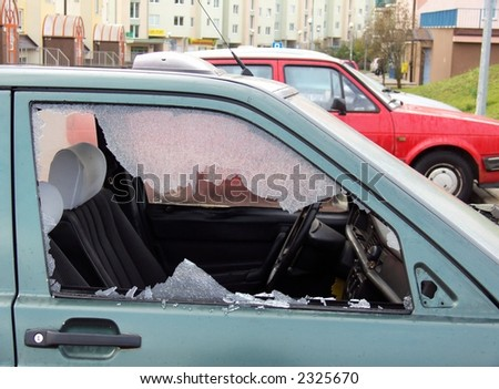 bad day for owner car - vandal or thief or accident - destroyed window-pane,