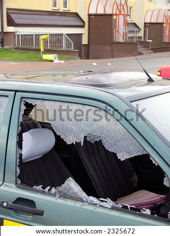 bad day for owner car - vandal or thief or accident - destroyed window-pane, probably vandal destroyed window-pane and wastepaper basket - stock photo