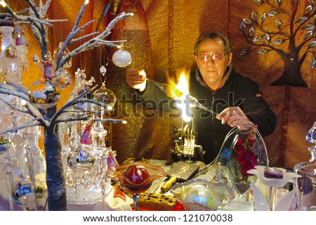 BAD HINDELANG, GERMANY - DECEMBER 4: Romantic Christmas market with illuminated shop of glassblower and bowls on December 4, 2012 in Bad Hindelang, Bavaria, Germany