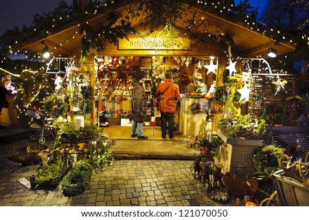 BAD HINDELANG, GERMANY - DECEMBER 4: Romantic Christmas market with illuminated shops for gift and decoration on December 4, 2012 in Bad Hindelang, Bavaria, Germany - stock photo