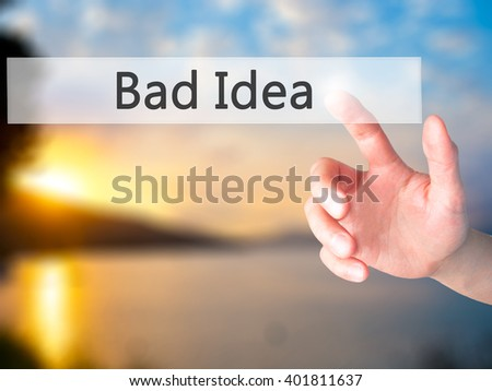 Bad Idea - Hand pressing a button on blurred background concept . Business, technology, internet concept. Stock Photo