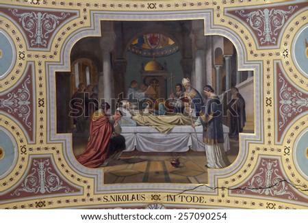 BAD ISCHL, AUSTRIA - DECEMBER 14: Death of saint Nicholas, fresco painting in parish church of St. Nicholas in Bad Ischl, Austria on December 14, 2014. - stock photo