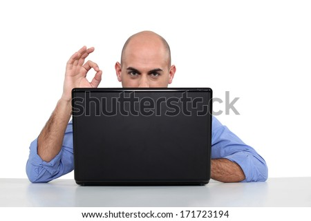 Bad man with laptop - stock photo