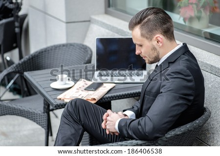 Bad news, bad luck, the deal fell through. Businessman sitting at table with her hands and looking down. - stock photo