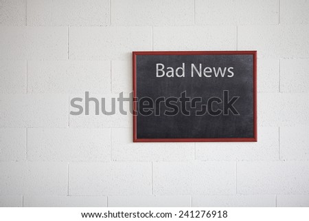 Bad news, writing on chalkboard