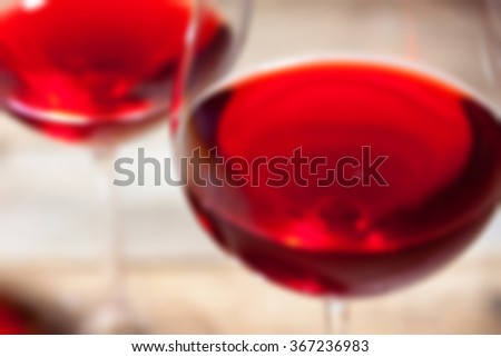 bad red wine in two goblets. romantic blur still life