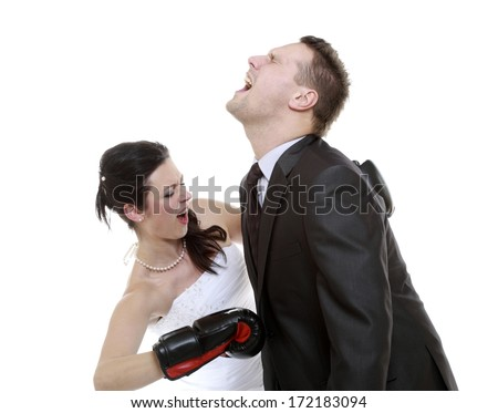 Bad relationship. Funny wedding couple expressive fighting. Woman showing her husband who's boss. Angry wife boxing husband. Isolated on white