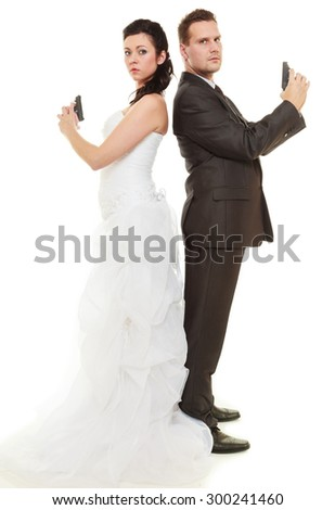 Bad relationship married couple in conflict. Bride and groom with handgun weapon isolated on white. Man and woman in disagreement. Divorce. - stock photo