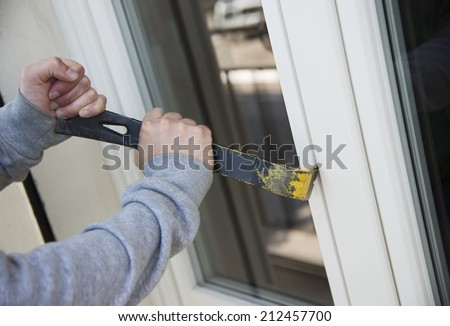 bad thief breaking a window for stealing - stock photo