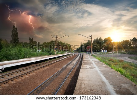 Bad weather and storm clouds over railroad - stock photo