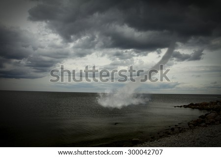 Bad weather and the storm with the wind on the sea. tornado over the ocean