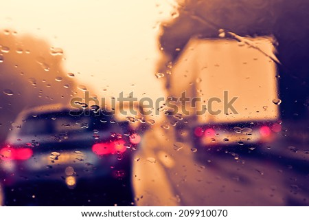 Bad weather driving on a highway - stock photo