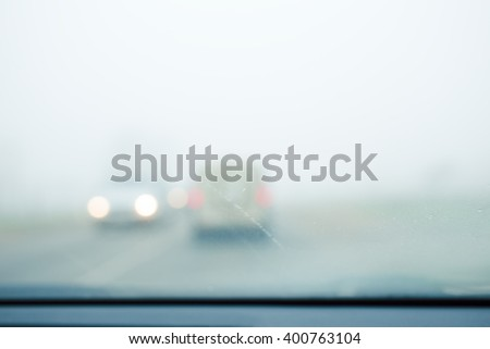 Bad weather driving - thick fog - stock photo