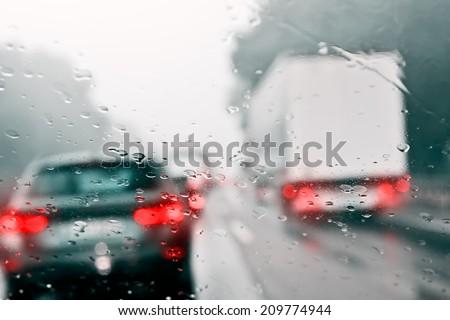 Bad Weather Driving - Traffic Jam on an Expressway (Motorway) - stock photo