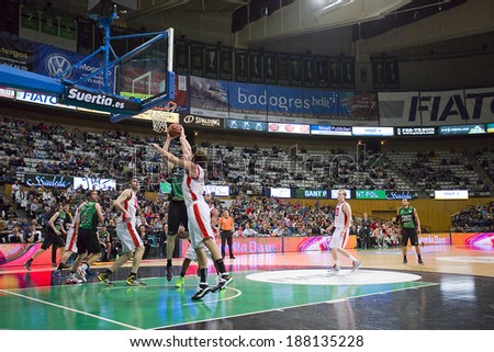BADALONA, SPAIN - APRIL 13: Some players in action at Spanish Basketball League match between Joventut and Zaragoza, final score 82-57, on April 13, 2014, in Badalona, Spain. - stock photo