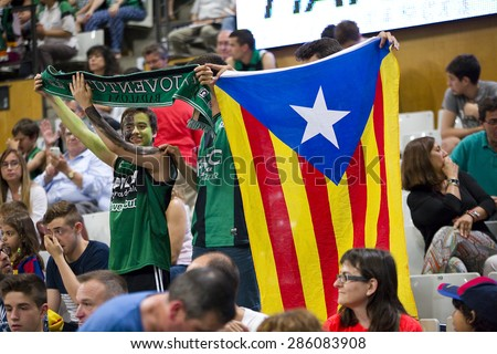 BADALONA, SPAIN - MAY 30: Supporters at Spanish ACB Basketball League match between Joventut Badalona and FC Barcelona, final score 74-80, on May 30, 2015, in Badalona, Spain. - stock photo