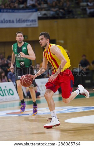 BADALONA, SPAIN - MAY 30: Tomas Satoransky of FCB in action at Spanish ACB Basketball League match between Joventut Badalona and FC Barcelona, final score 74-80, on May 30, 2015, in Badalona, Spain. - stock photo