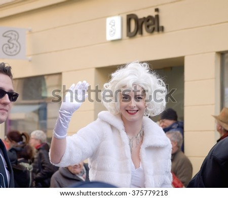 Baden bei Wien, AUSTRIA - 09  February 2016: A disguised woman on a carnival float greeting the visitors of a carnival parade in Baden bei Wien, Austria.