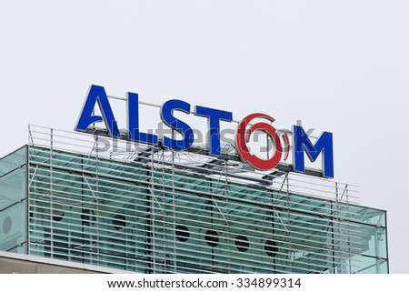 BADEN, SWITZERLAND. October 31, 2015. Last days of the Alstom logo on rooftop of thermal power headquarters before merger and acquisition of General Electric on 2nd November 2015. - stock photo