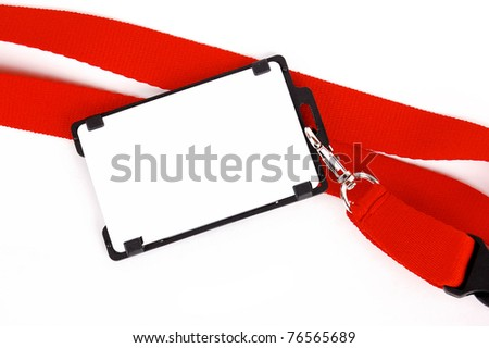 badge with a red ribbon on a white background