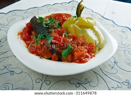Badimcan, biber, pomidor dolmasi - Stuffed aubergines, peppers and tomatoes.popular dolma across Azerbaijan. - stock photo