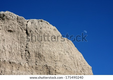 Badlands and moon - stock photo