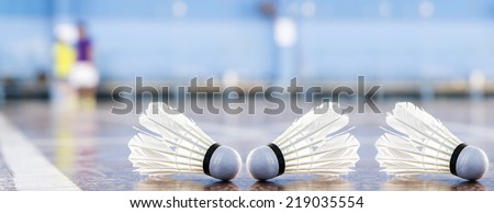badminton - badminton courts with players competing(shallow DOF; color toned image) - stock photo