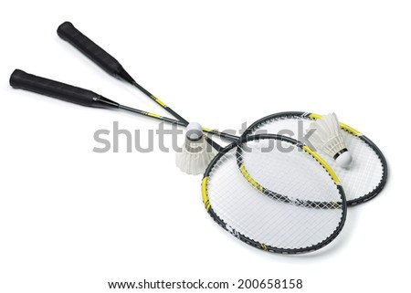 Badminton rackets and shuttlecocks isolated on white - stock photo
