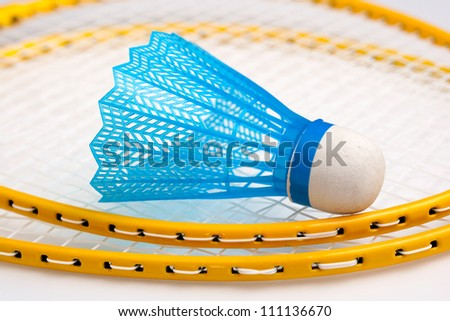 Badminton rackets with a shuttle - stock photo