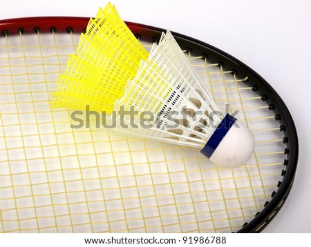 badminton racquet with two balls