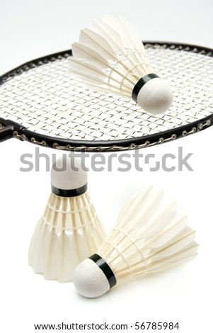 Badminton shuttlecocks with the racket - stock photo