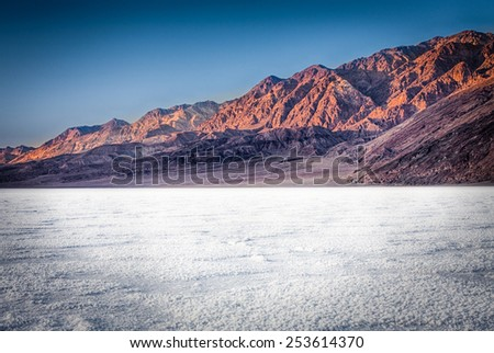 Badwater salt flats at sunset - stock photo